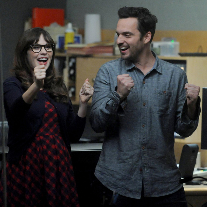 NEW GIRL: Jess (Zooey Deschanel, L) and Nick (Jake Johnson, R) are excited when Coach and May reconcile in the
