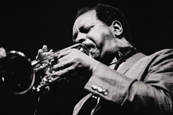 Ornette Coleman, jazz musician Coleman blowing the trumpet