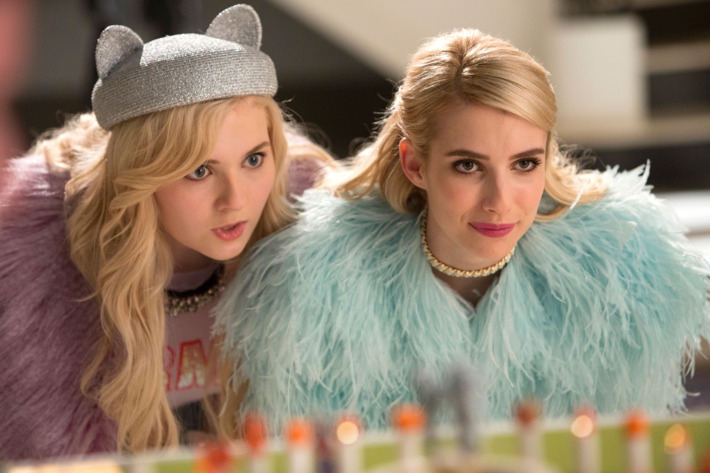 """SCREAM QUEENS: Pictured L-R: Abigail Breslin as Chanel #5 and Emma Roberts as Chanel Oberlin in the """"Pumpkin Patch"""" episode of SCREAM QUEENS airing Tuesday, Oct. 13 (9:00-10:00 PM ET/PT) on FOX. ©2015 Fox Broadcasting Co. Cr: Steve Dietl/FOX."""