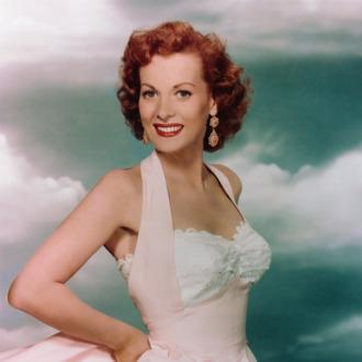 Maureen O'Hara Wearing a Pink Evening Gown