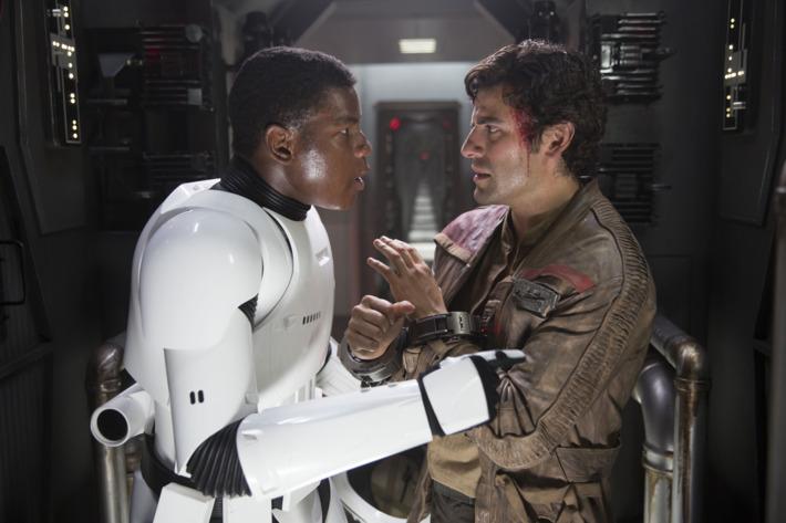 Star Wars: The Force AwakensL to R: Finn (John Boyega) and Poe Dameron (Oscar Isaac)Ph: David James© 2015 Lucasfilm Ltd. & TM. All Right Reserved.