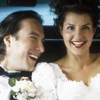 My Big Fat Greek Wedding (2002)Directed by Joel Zwick Shown: John Corbett (as Ian Miller), Nia Vardalos (as Toula Portokalos)