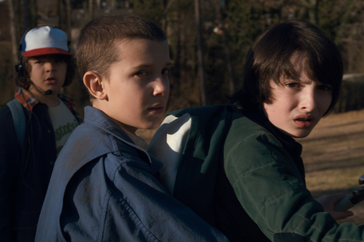 Gaten Matarazzo as Dustin, Millie Bobby Brown as Elle, Finn Wolfhard as Mike.