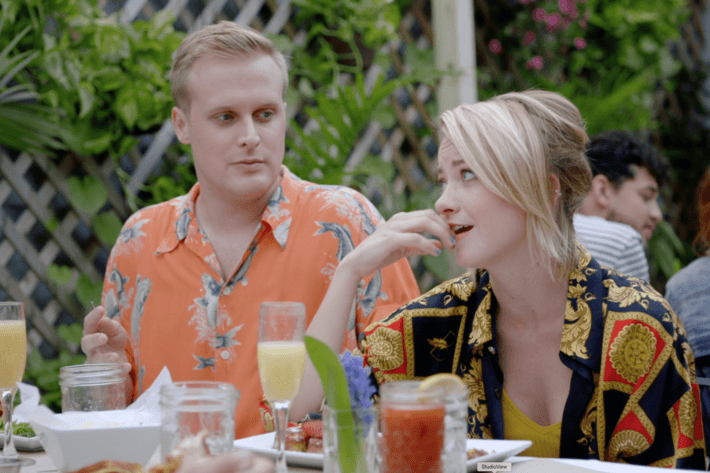 John Early as Elliott, Meredith Hagner as Portia.