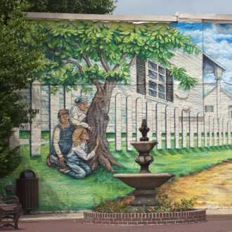 Mural depicting actors in the play and book, To Kill a Mockingbird. Located in historic downtown Mon