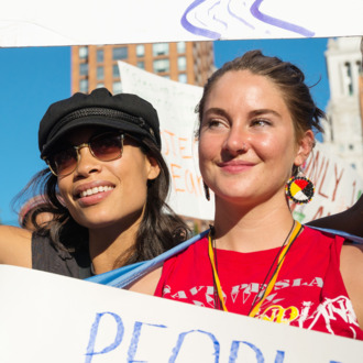 Rosario Dawson (left) and Shailene Woodley (center) pose for