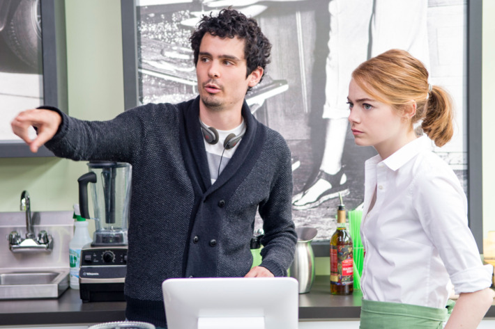 Director Damien Chazelle and Emma Stone on the set of LA LA LAND.