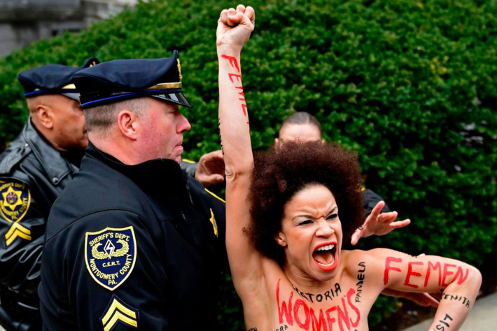 Protester Nicolle Rochelle is arrested outside the Montgomery County  Courthouse in Norristown, Pennsylvania. Photo: Corey  Perrine/AP/REX/Shutterstock