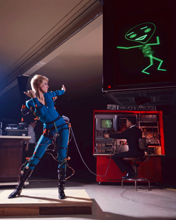A Turn-On dancer, seen using a primitive form of motion capture to render the stick figure on the monitor.