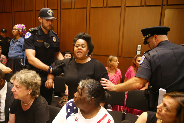 Another protester getting escorted out during the Kavanaugh hearing.