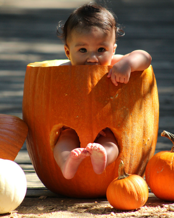 A baby in a pumpkin.