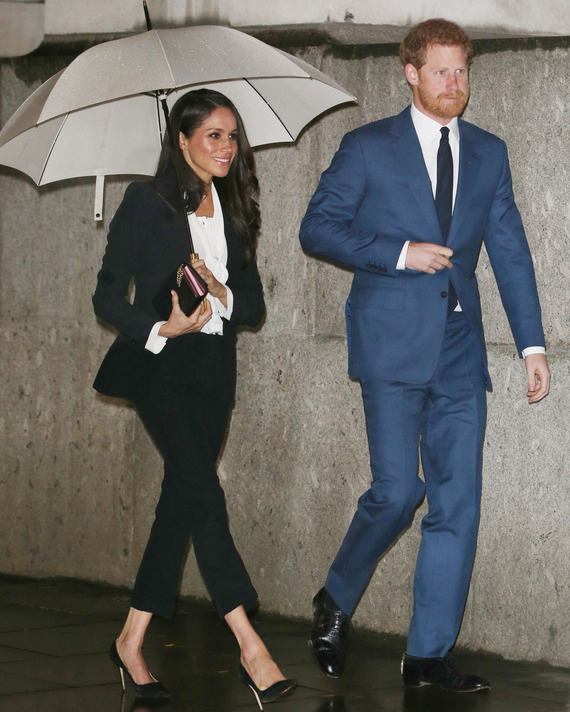 Meghan Markle and Prince Harry, both in suits.