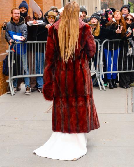 Jennifer Lopez wears Stephane Rolland pants with train