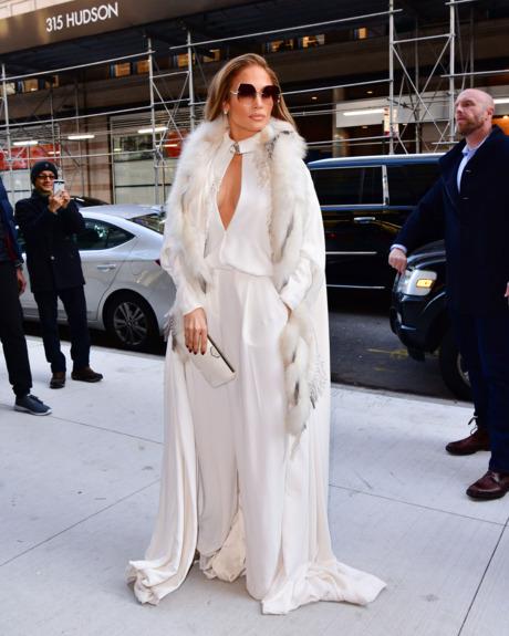 Jennifer Lopez in a white coat