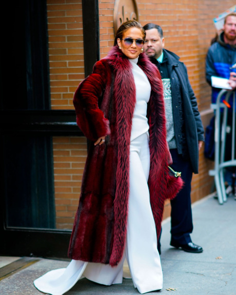 Jennifer Lopez in burgundy fur coat.