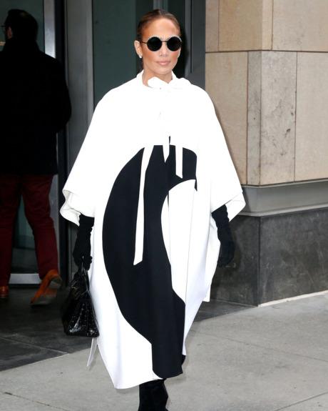 Jennifer Lopez in a black and white coat.