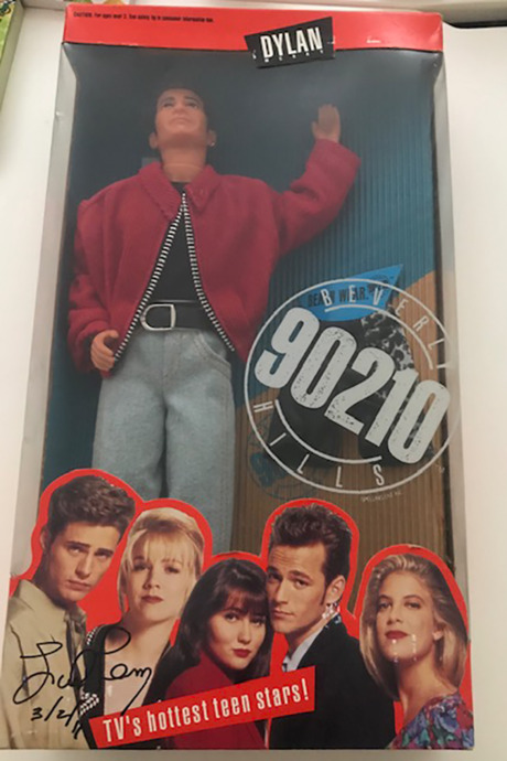 The signed Dylan McKay doll.