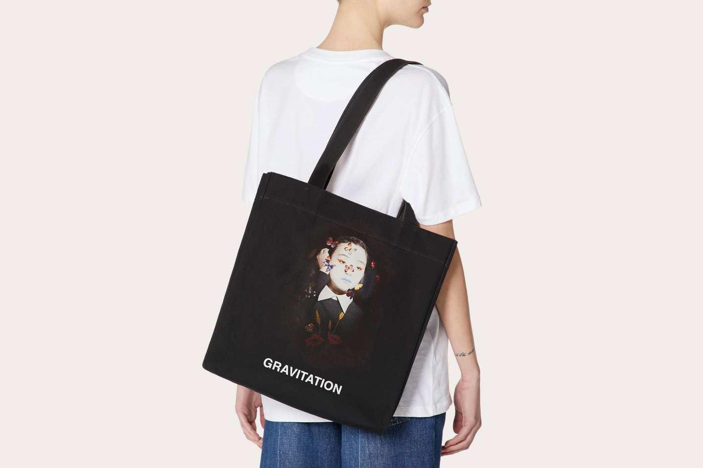 "Shopper With ""Gravitation"" Print"