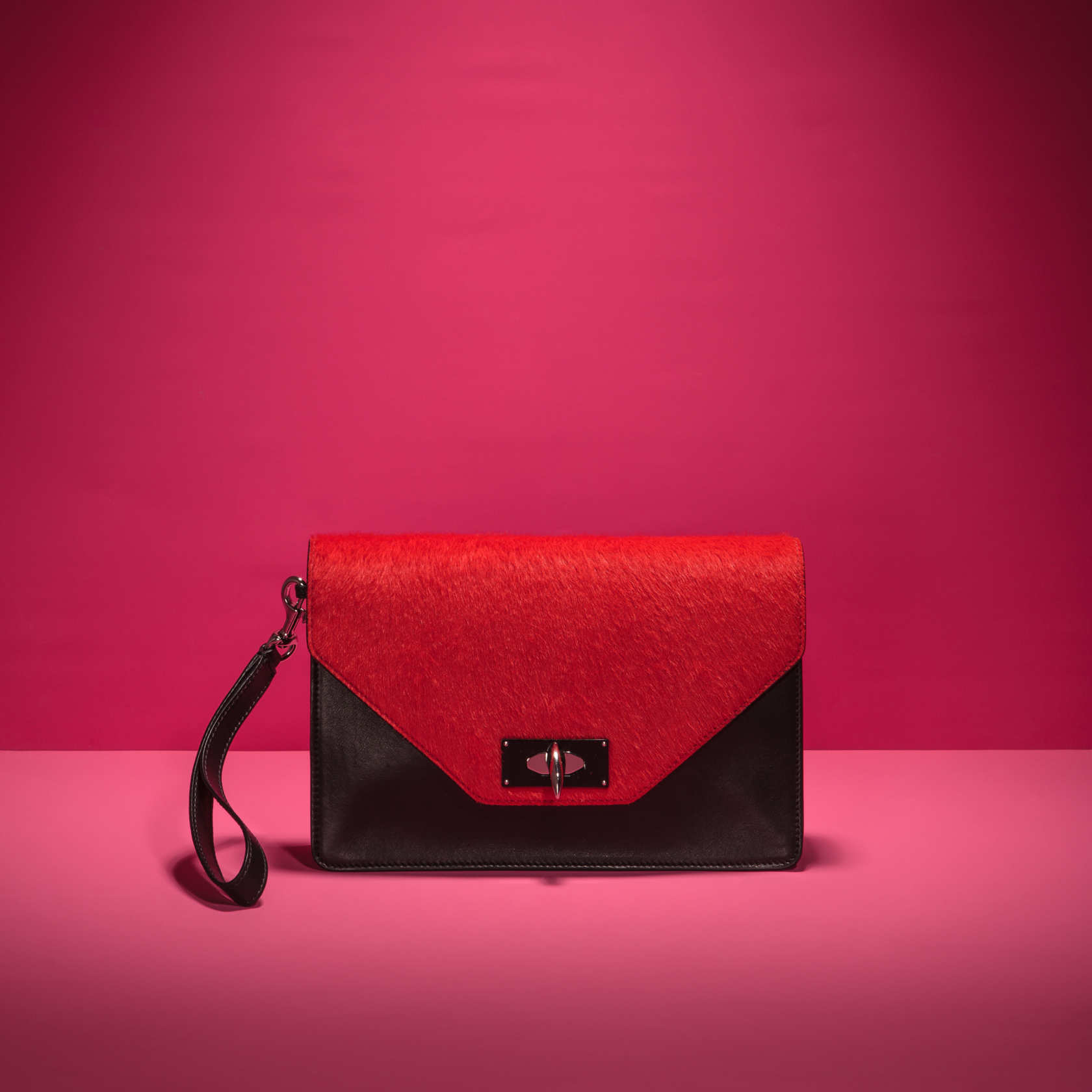 be1bf2d76e44 Fall Bag Guide Givenchy by Riccardo Tisci red pony hair and black leather  shark tooth clutch